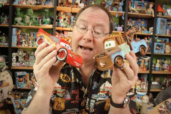 John Lasseter, actually playing with his toys.