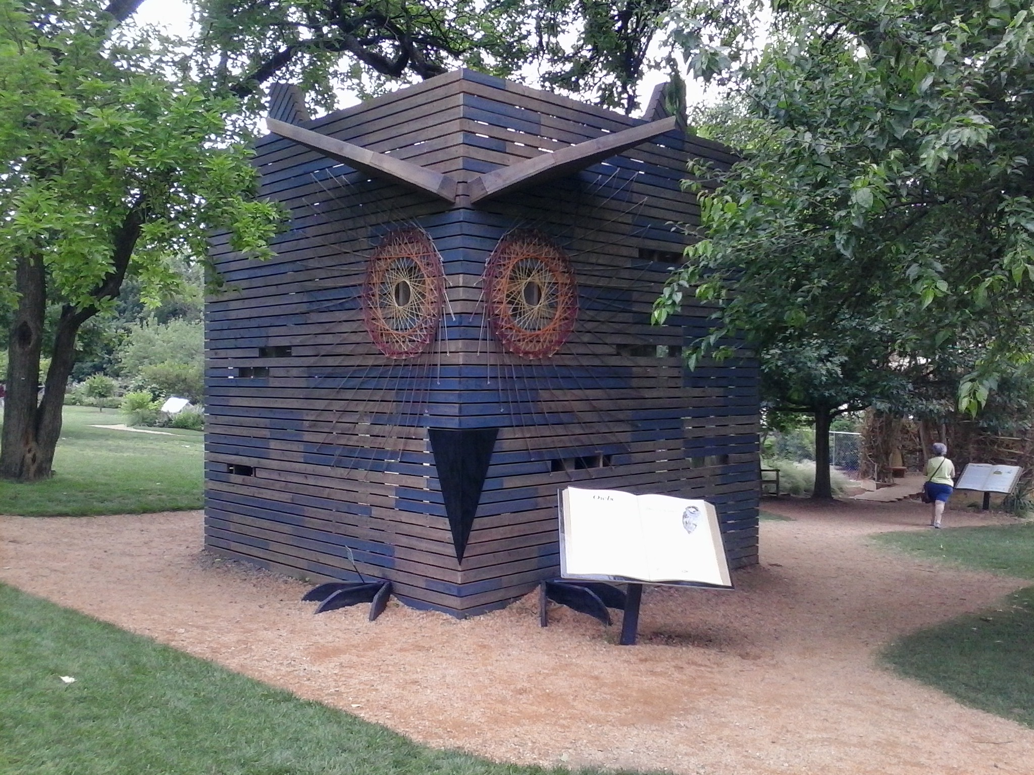 An owl-shaped house in the bird exhibit.